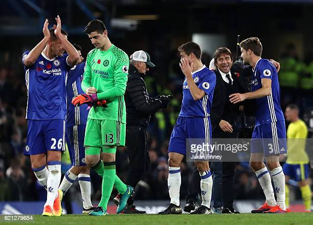 Antonio Conte Manager of Chelsea embraces Marcos Alonso of Chelsea after the final whistle during the Premier League match between Chelsea and...