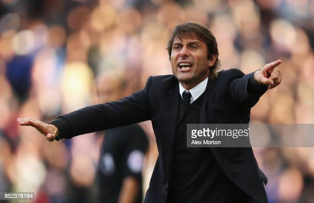 Antonio Conte Manager of Chelsea gestures during the Premier League match between Stoke City and Chelsea at Bet365 Stadium on September 23 2017 in...