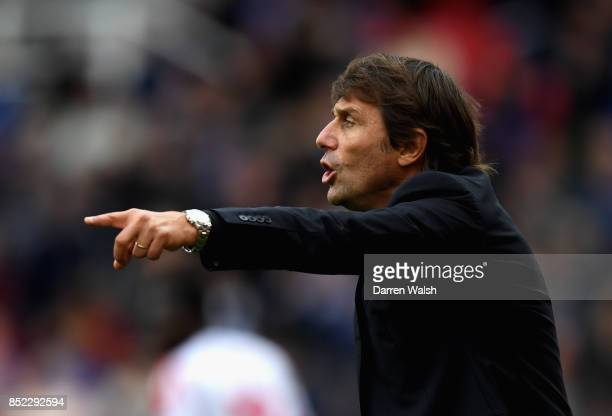 Antonio Conte Manager of Chelsea gives his team instructions during the Premier League match between Stoke City and Chelsea at Bet365 Stadium on...