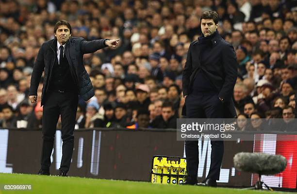 Antonio Conte Manager of Chelsea gives his team instructions while Mauricio Pochettino Manager of Tottenham Hotspur looks on during the Premier...