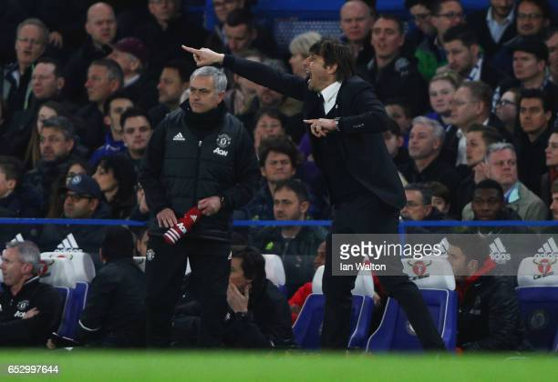 Antonio Conte manager of Chelsea gives instructions as Jose Mourinho manager of Manchester United looks on during The Emirates FA Cup QuarterFinal...