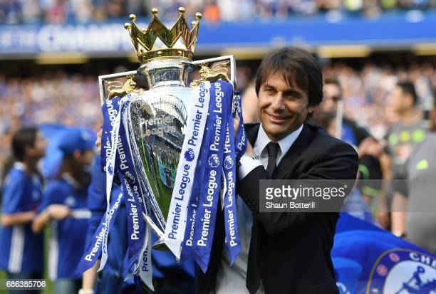 Antonio Conte Manager of Chelsea holds the trophy following the Premier League match between Chelsea and Sunderland at Stamford Bridge on May 21 2017...