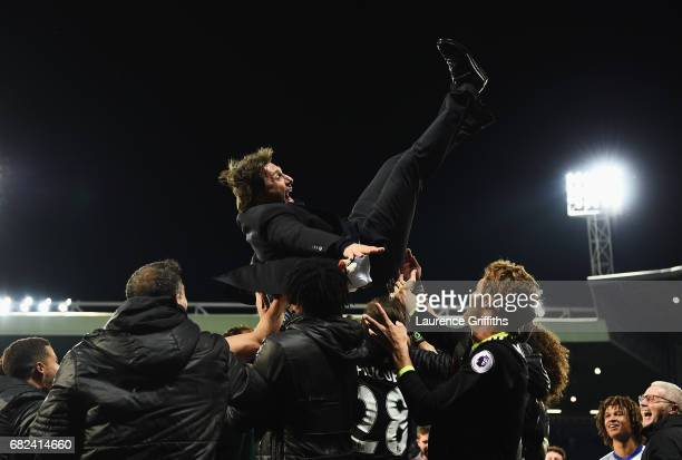 Antonio Conte Manager of Chelsea is chucked in the air by his team as they celebrate winning the leauge after the Premier League match between West...