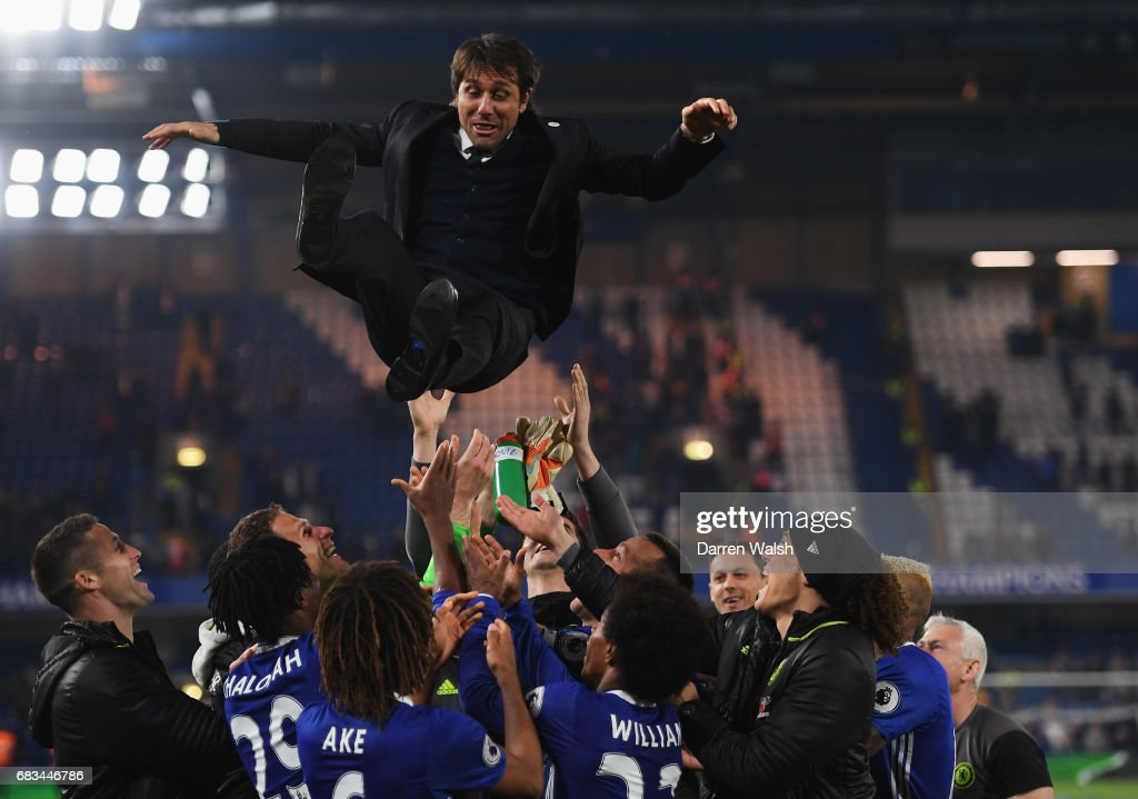 Antonio Conte, Manager of Chelsea is thrown in the air by his team as part of celebrations after the Premier League match between Chelsea and Watford at Stamford Bridge on May 15, 2017 in London, England.
