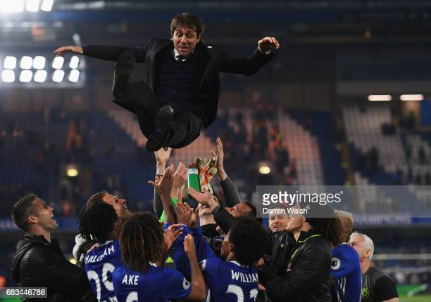 Antonio Conte Manager of Chelsea is thrown in the air by his team as part of celebrations after the Premier League match between Chelsea and Watford...