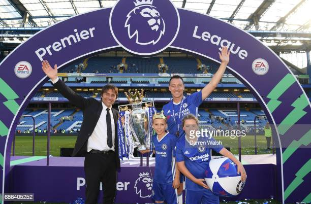 Antonio Conte Manager of Chelsea John Terry of Chelsea and his two children Georgie John and Summer Rose Terry pose with the Premier League Trophy...