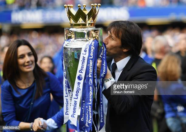 Antonio Conte Manager of Chelsea kisses the Premier League Trophy after the Premier League match between Chelsea and Sunderland at Stamford Bridge on...