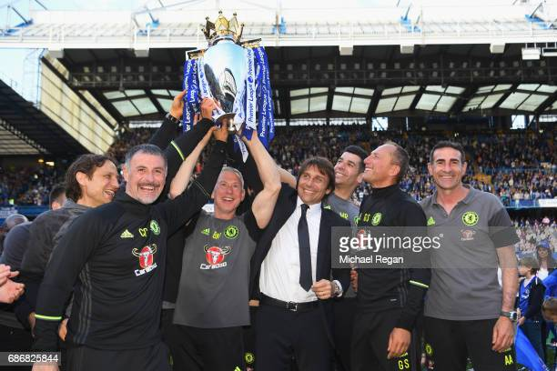 Antonio Conte Manager of Chelsea poses with backroom staff and the Premier League Trophy after the Premier League match between Chelsea and...