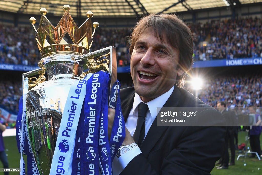 Antonio Conte, Manager of Chelsea poses with the Premier League Trophy after the Premier League match between Chelsea and Sunderland at Stamford Bridge on May 21, 2017 in London, England.