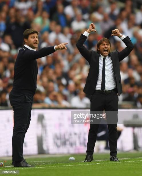 Antonio Conte Manager of Chelsea reacts as Mauricio Pochettino Manager of Tottenham Hotspur gives his team instructions during the Premier League...