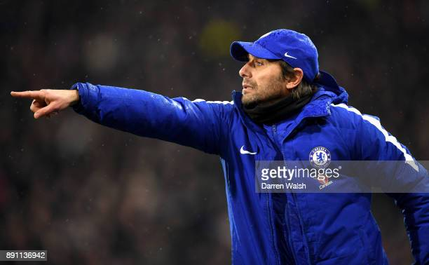 Antonio Conte Manager of Chelsea reacts during the Premier League match between Huddersfield Town and Chelsea at John Smith's Stadium on December 12...