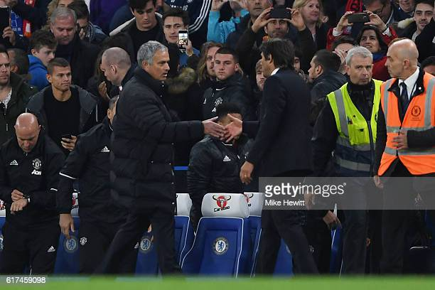 Antonio Conte Manager of Chelsea shakes hands with Jose Mourinho Manager of Manchester United after the full time whistle during the Premier League...