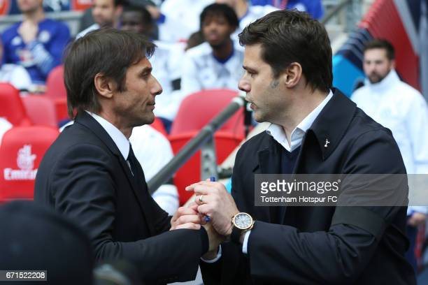 Antonio Conte Manager of Chelsea shakes hands with Mauricio Pochettino Manager of Tottenham Hotspur prior to The Emirates FA Cup SemiFinal between...