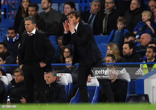 Antonio Conte manager of Chelsea shouts as Claude Puel manager of Southampton looks on during the Premier League match between Chelsea and...