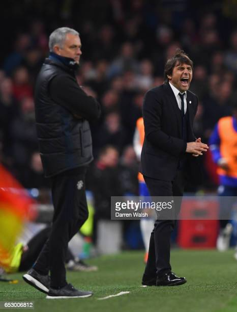 Antonio Conte manager of Chelsea shouts as Jose Mourinho manager of Manchester United looks on during The Emirates FA Cup QuarterFinal match between...