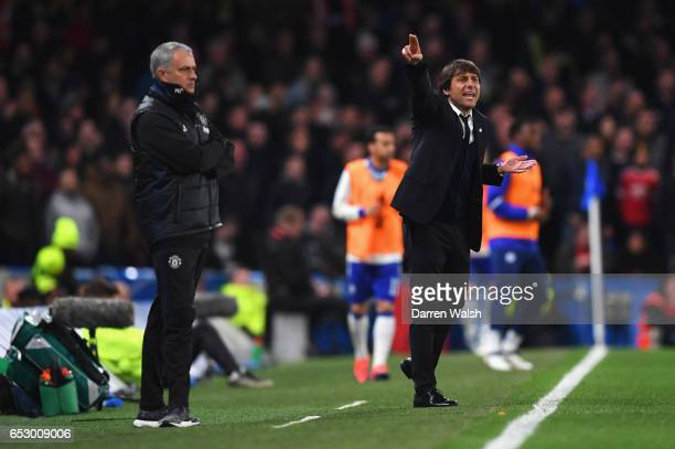 Antonio Conte manager of Chelsea signals as Jose Mourinho manager of Manchester United looks on during The Emirates FA Cup QuarterFinal match between...