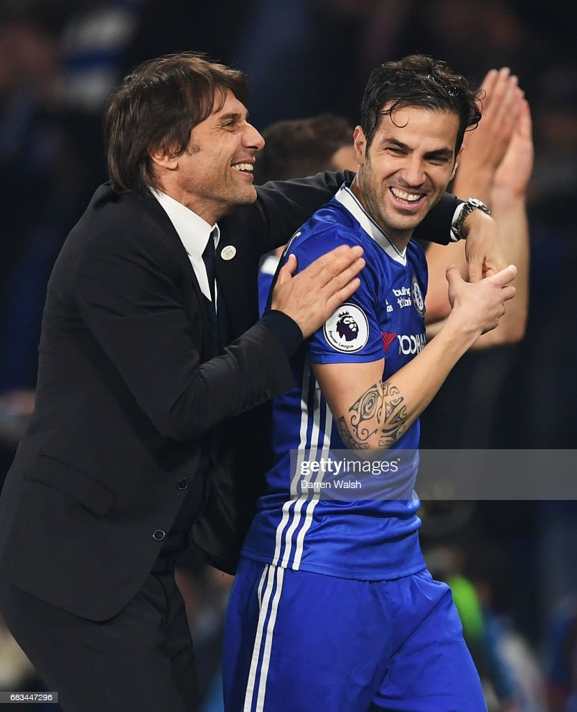 Antonio Conte, Manager of Chelsea speaks to Cesc Fabregas of Chelsea after the Premier League match between Chelsea and Watford at Stamford Bridge on May 15, 2017 in London, England.