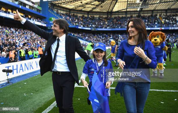 Antonio Conte Manager of Chelsea Vittoria daughter and Elisabetta Conte wife walk around the pitch celebrating after the Premier League match between...