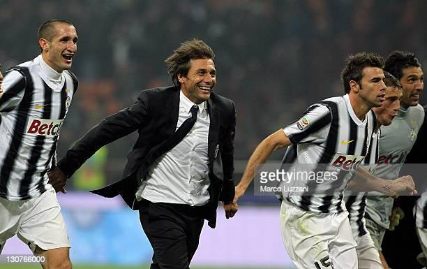 Antonio Conte manager of Juventus FC celebrates a victory with Giorgio Chiellini Andrea Barzagli Claudio Marchisio and Gianluigi Buffon at the end of...
