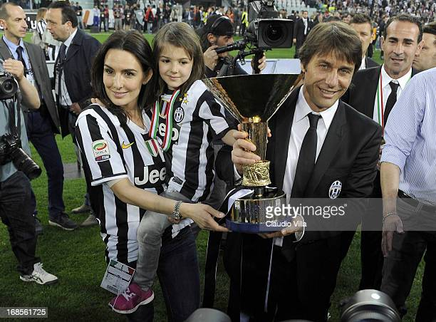 Antonio Conte of Juventus FC and his family celebrate with the Serie A trophy after the Serie A match between Juventus and Cagliari Calcio at...