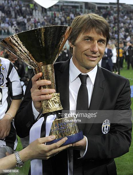 Antonio Conte of Juventus FC celebrates with the Serie A trophy after the Serie A match between Juventus and Cagliari Calcio at Juventus Arena on May...
