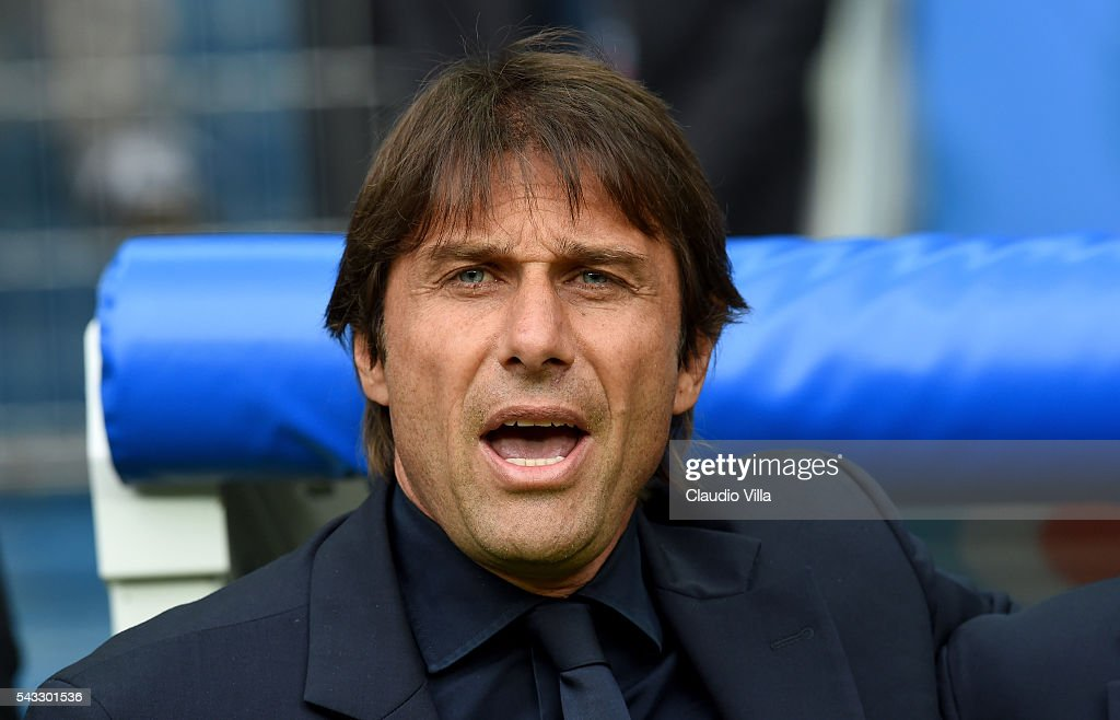 Antonio Conte sings the national anthem prior to the UEFA EURO 2016 round of 16 match between Italy and Spain at Stade de France on June 27, 2016 in Paris, France.