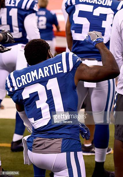 Antonio Cromartie of the Indianapolis Colts kneels and raises his fist during the National Anthem before the start of the game against the San Diego...