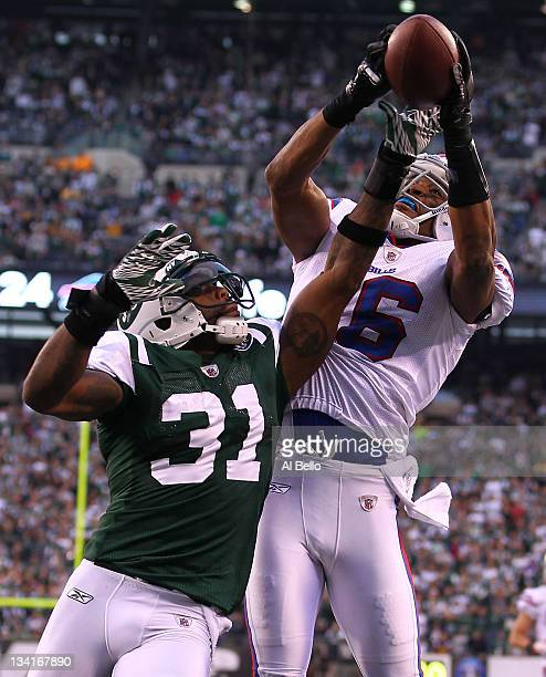 Antonio Cromartie of the New York Jets breaks up the second to last play of the game against Brad Smith of the Buffalo Bills to preserve a 2824 win...