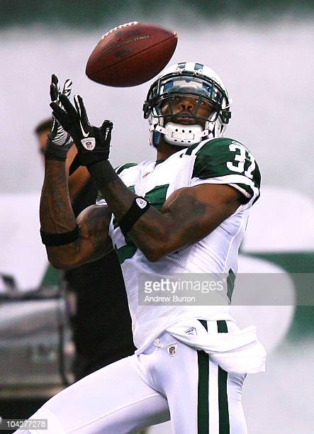 Antonio Cromartie of the New York Jets intercepts a pass from Tom Brady of the New England Patriots intended for Randy Moss at the New Meadowlands...