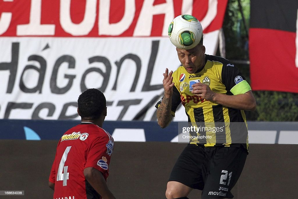 Antonio Da Silva of Caracas FC competes for the ball with Daniel Rouga of Deportivo Tachira during a match between Caracas FC and Deportivo Tachira as part of the Torneo Clausura 2013 at Olympic stadium on May 12, 2013 in Caracas, Venezuela.
