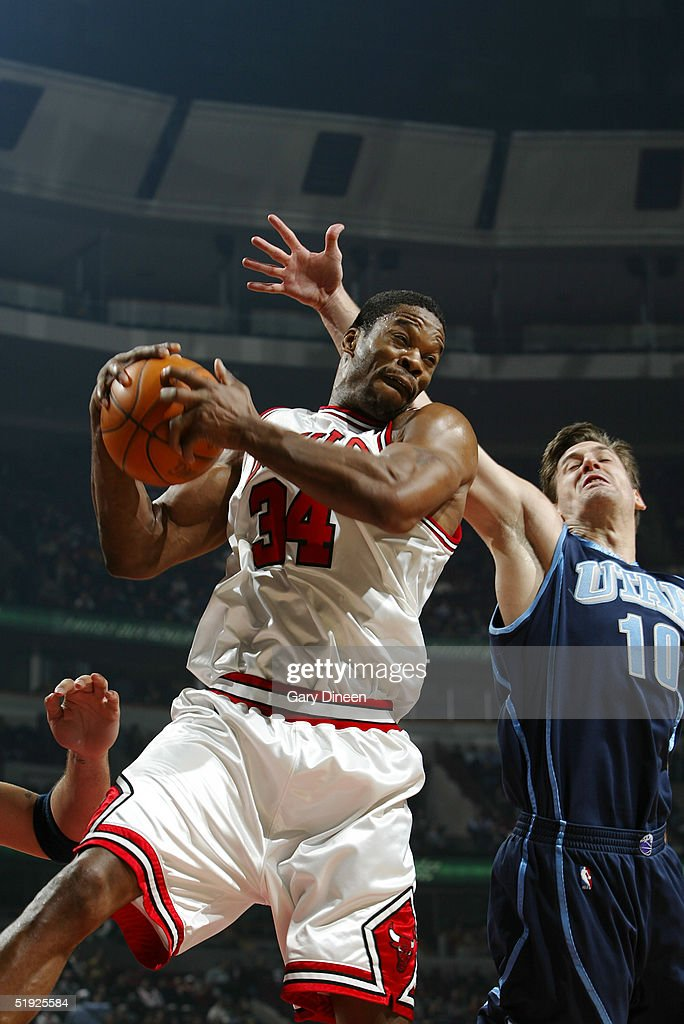 Antonio Davis of the Chicago Bulls grabs a rebound from Gordan Giricek of the Utah Jazz during the first quarter of a NBA game at the United Center...
