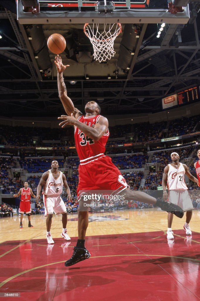 Antonio Davis of the Chicago Bulls lays up a shot against the Cleveland Cavaliers during the game on December 26 2003 at Gund Arena in Cleveland Ohio...