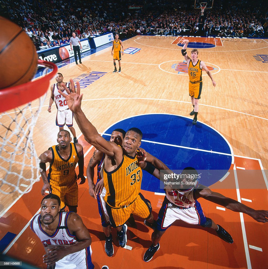 Antonio Davis of the Indiana Pacers drives to the basket against the New York Knicks during the Eastern Conferece Finals on June 4 1999 at Madison...