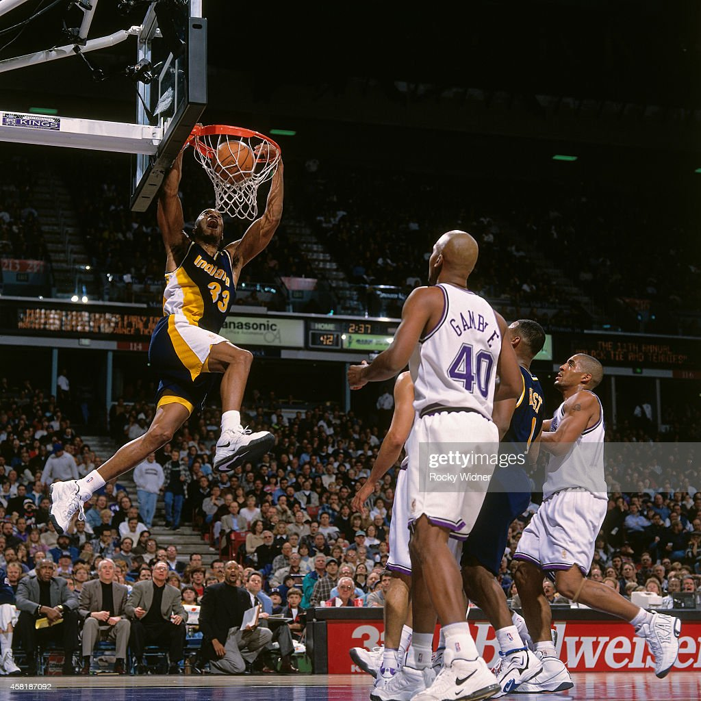 Antonio Davis of the Indiana Pacers dunks against the Sacramento Kings on January 14 1997 at Arco Arena in Sacramento California NOTE TO USER User...