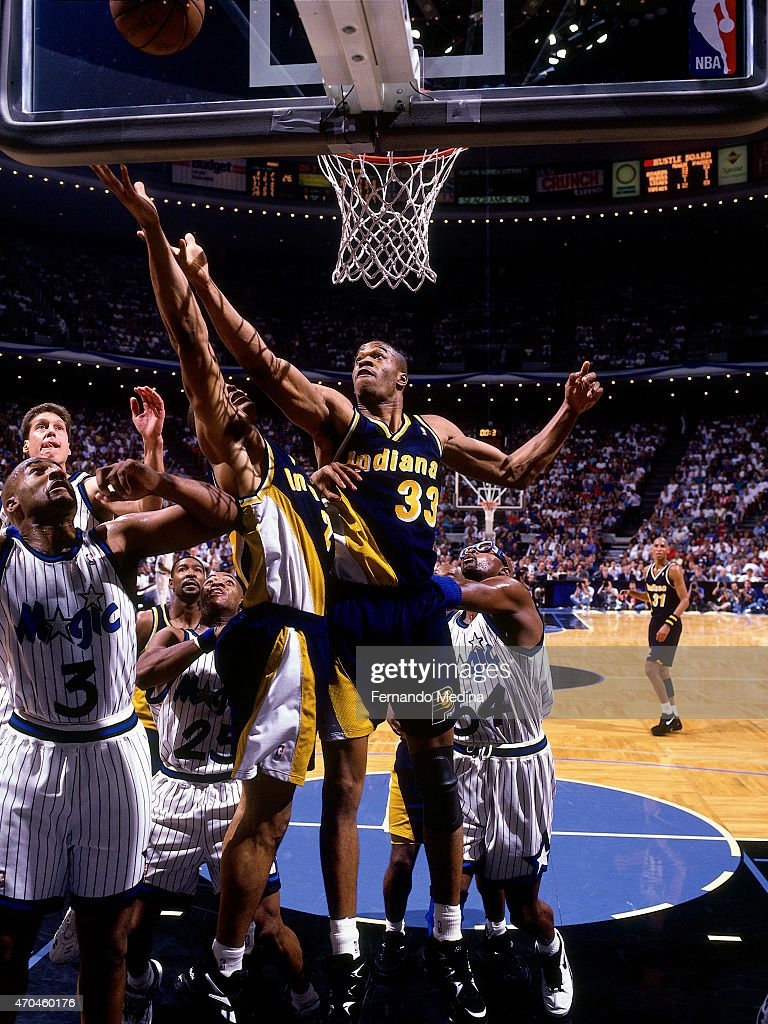 Antonio Davis of the Indiana Pacers goes up for a rebound against the Orlando Magic during game 5 of the Eastern Conference Finals on May 31 1995 at...