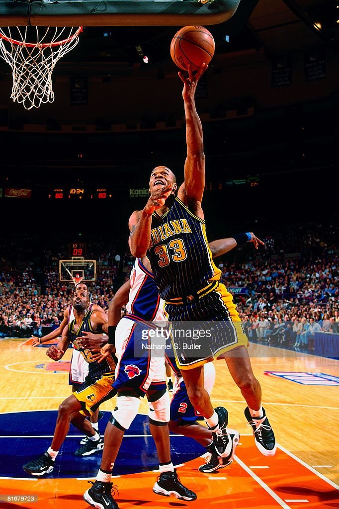 Antonio Davis of the Indiana Pacers shoots a layup against Patrick Ewing of the New York Knicks in Game Four of the Eastern Conference Semifinals...