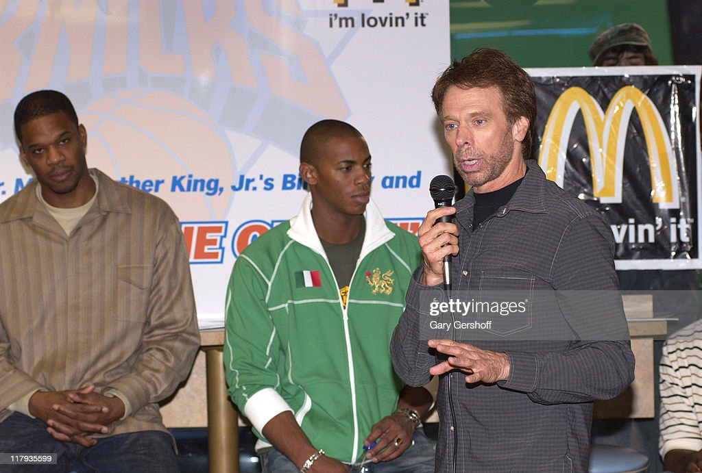 Antonio Davis of the New York Knicks Mehcad Brooks and Jerry Bruckheimer producer of 'Glory Road'