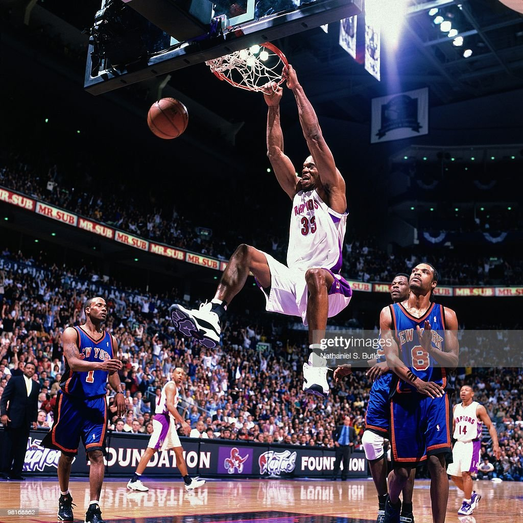Antonio Davis of the Toronto Raptors dunks against Latrell Sprewell of the New York Knicks during Game Three of the 2000 Eastern Conference...