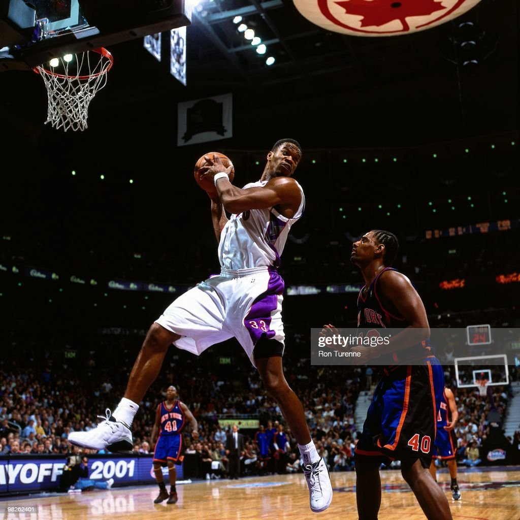 Antonio Davis of the Toronto Raptors rebounds against the New York Knicks during a game played in 2001 at the Air Canada Centre in Toronto Canada...