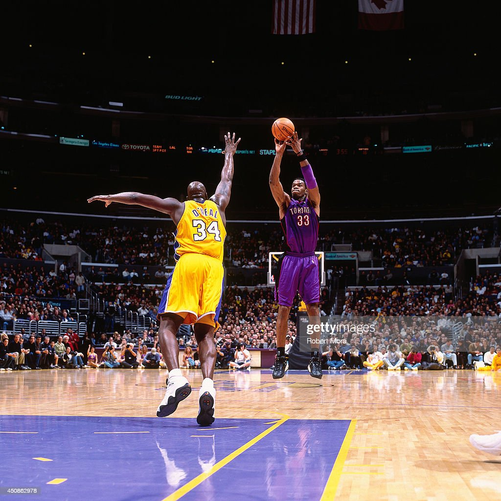 Antonio Davis of the Toronto Raptors shoots the ball against Shaquille O'Neal the Los Angeles Lakers on March 7 2001 at Staples Center in Los Angeles...