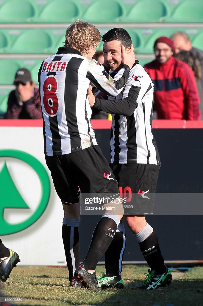 Antonio Di Natale and Dusan Basta of Udinese Calcio celebrate after Di Natale shot a goal during the Serie A match between Udinese Calcio and FC...