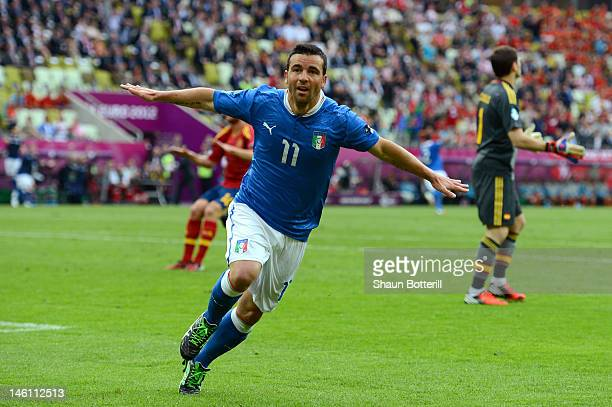 Antonio Di Natale of Italy celebrates scoring their first goal during the UEFA EURO 2012 group C match between Spain and Italy at The Municipal...