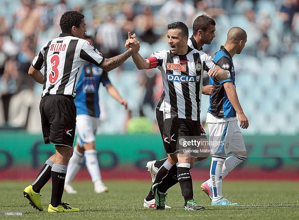 <a gi-track='captionPersonalityLinkClicked' href=/galleries/search?phrase=Antonio+Di+Natale&family=editorial&specificpeople=727545 ng-click='$event.stopPropagation()'>Antonio Di Natale</a> (R) of Udinese Calcio celebrates after scoring a goal during the Serie A match between Udinese Calcio and Atalanta BC at Stadio Friuli on May 12, 2013 in Udine, Italy.