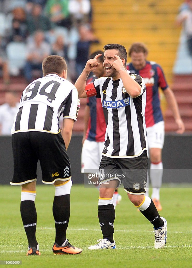 Antonio Di Natale (C) of Udinese Calcio celebrates after scoring his first goal during the Serie A match between Udinese Calcio and Bologna FC at Stadio Friuli on September 15, 2013 in Udine, Italy.