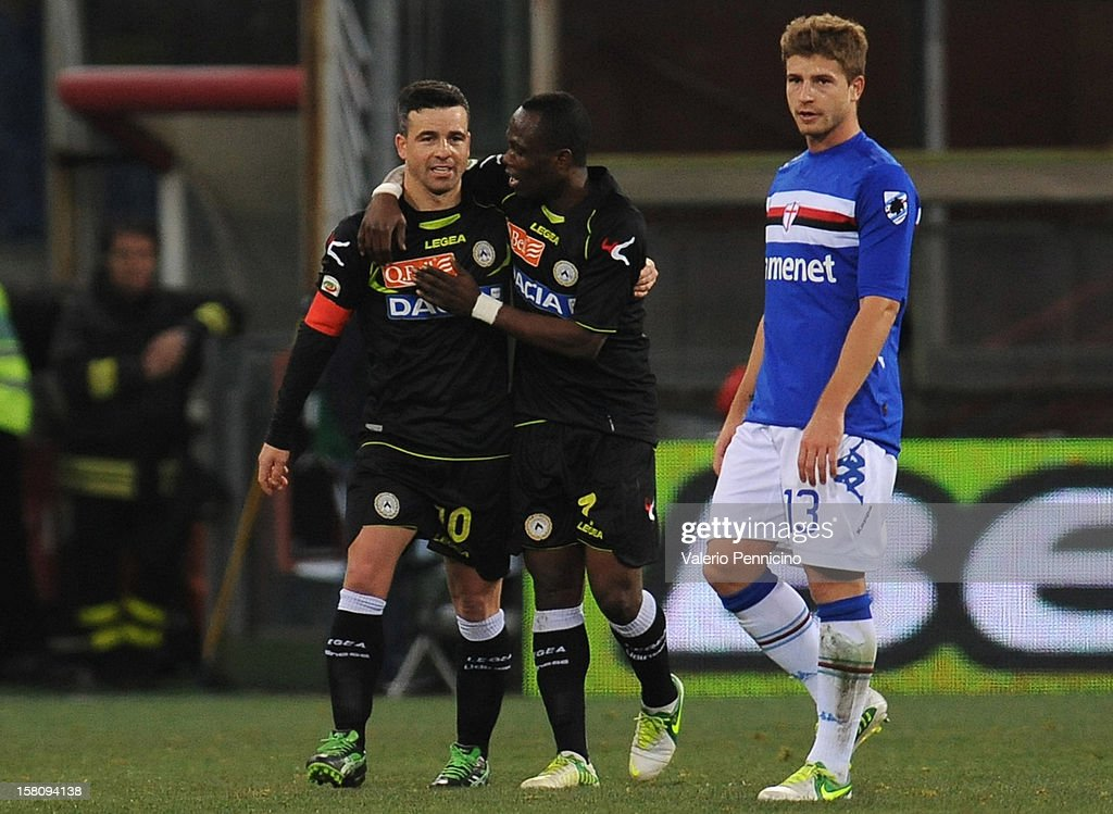 <a gi-track='captionPersonalityLinkClicked' href=/galleries/search?phrase=Antonio+Di+Natale&family=editorial&specificpeople=727545 ng-click='$event.stopPropagation()'>Antonio Di Natale</a> (L) of Udinese Calcio celebrates his goal with team-mates Badu during the Serie A match between UC Sampdoria and Udinese Calcio at Stadio Luigi Ferraris on December 10, 2012 in Genoa, Italy.