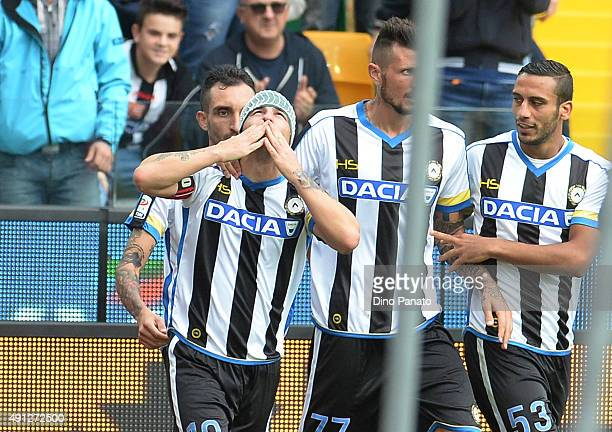 Antonio Di Natale of Udinese Calcio celebrates with team mates after scoring his opening goal during the Serie A match between Udinese Calcio and...