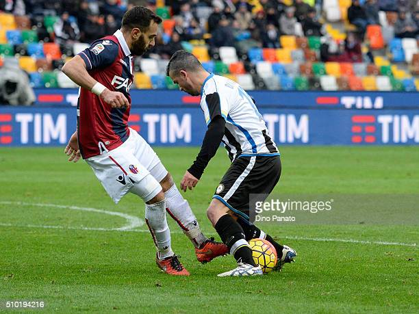 Antonio Di Natale of Udinese Calcio competes with Domenico Maietta of Bologna FC during the Serie A match between Udinese Calcio and Bologna FC at...