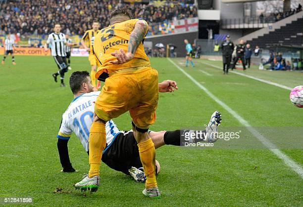 Antonio Di Natale of Udinese Calcio competes with Eros Pisano of Hellas Verona during the Serie A match between Udinese Calcio and Hellas Verona FC...