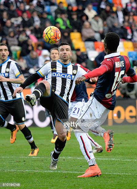 Antonio Di Natale of Udinese Calcio competes with Ibrahima Mbaye of Bologna FC during the Serie A match between Udinese Calcio and Bologna FC at...