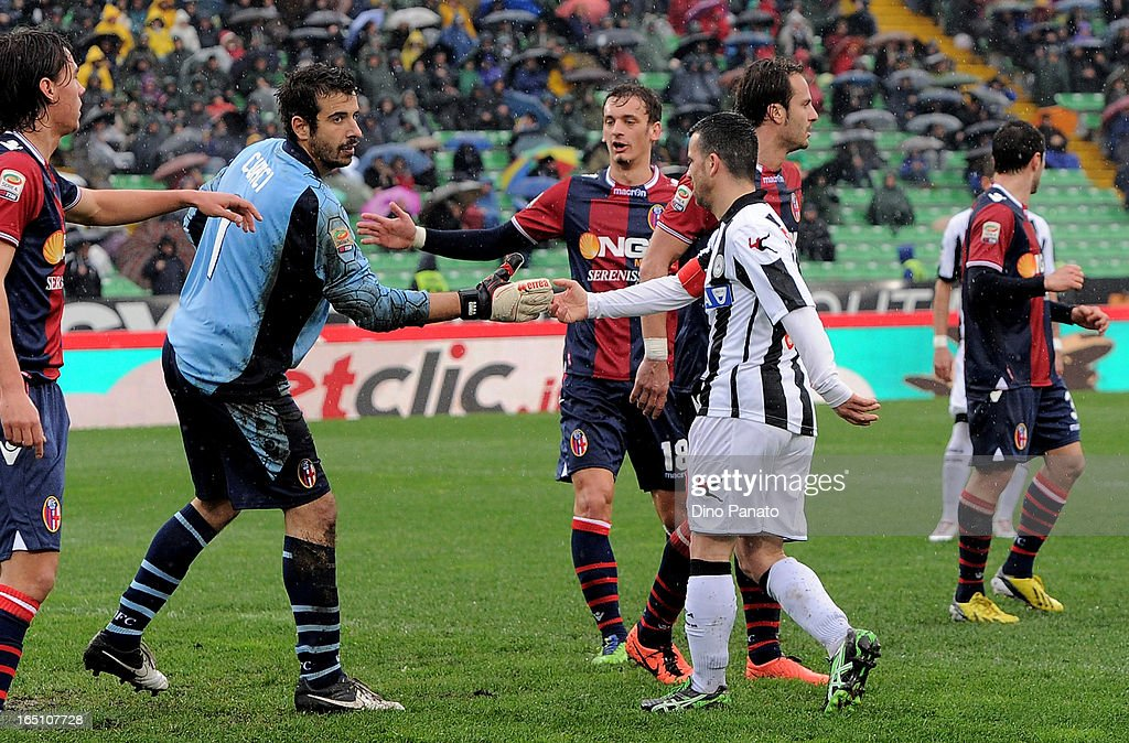 Antonio Di Natale (R) of Udinese Calcio shakes hands with <a gi-track='captionPersonalityLinkClicked' href=/galleries/search?phrase=Gianluca+Curci&family=editorial&specificpeople=605364 ng-click='$event.stopPropagation()'>Gianluca Curci</a> (L) goalkeeper of Bologna FC after he saved his penalty during the Serie A match between Udinese Calcio and Bologna FC at Stadio Friuli on March 30, 2013 in Udine, Italy.